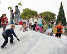 Islamorada Holiday Festival, Florida Keys - Children delight in playing with snow in the subtropical Keys climate.