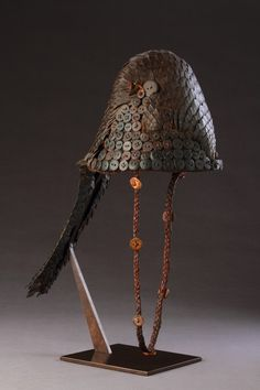 Africa | Bwami society ceremonial hat / headdress from the Lega people, of the Kivu region, DR Congo | Formed from the bony armoured skin of a Temmincks pangolin.  Buttons and basketry | Early 20th century