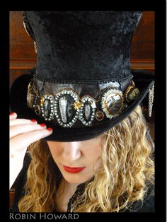 """Care for some Tea""  Bead Embroidered Steampunk Top Hat, presently this piece is entered into the Fire Mountain Gems Seed Bead Contest and has cleared the first round of judging.  Materials: Fossils, 1800's pocket watches, minerals, amber, sharks teeth, green jasper, sterling silver, chain, Swarovski Crystals, large faceted Smokey quartz, quartz, various seed beads, fire polished crystals, and a whole lot more. Top hat itself hand made by the Gypsy Ladies"