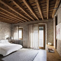 I love the ceilings & the walls. I'd love to have brick/stone walls so the furniture/any textiles can really pop.