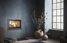 Contura's cast iron fireplace inserts are the energy efficient choice for those installing their own fireplace. Cast Iron Fireplace Insert, Wood Burning Fireplace Inserts, Focus Fireplaces, Fireplace Surrounds, Cosy Fireplace, Fireplace Design, Inset Stoves, Modern Stoves, Home Design Magazines