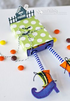Betsy Veldman has designed one of the cutest treat boxes I've ever seen! This adorable Halloween box was made with a match box die, adding straws for legs,  shoes made with felt using another…
