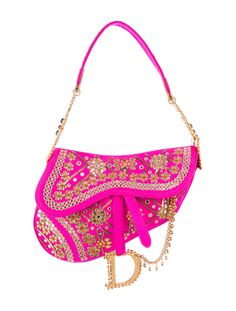 Neon pink Sari inspired Christian Dior Saddle bag with gold-tone hardware, sequin and embroidered embellishments throughout, single interior zip pocket, logo pieces at straps and front magnetic flap closure. Shop Christian Dior handbags on sale at The RealReal.