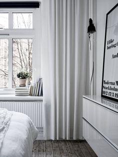 bedroom windowsill with books