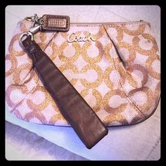 "Coach Wristlet Pink ""C"" shimmery Coach Wristlet, used but still in good condition. No tears inside or outside the Wristlet. Fits a iPhone6 and other necessities. Coach Bags Clutches & Wristlets"
