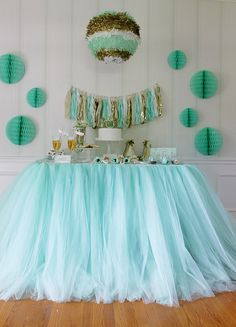 Tulle ~ skirt a dessert table with layer upon layer of this frothy fabric, it is a highly stylish way to decorate! Love this Dreamy Mint Green :)