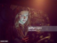 Foto stock : teenage girl on an iPad in a car at night