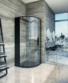 A curved corner shower enclosure gives flow to the angular situation, whilst a strong black finish provides edgy framing, and compliments the dark masculine vanity unit nearby. home-designing.com
