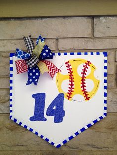A personal favorite from my Etsy shop https://www.etsy.com/listing/237828771/softball-home-plate-door-hangerwreath
