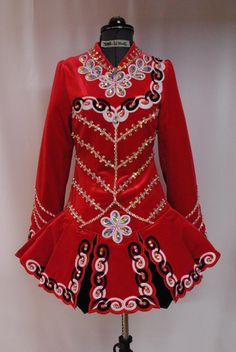 Stunning red Siopa Rince champion dress. Less than a year old and only worn 4 times. Selling due to growth spurt. My daughter is the original owner and thi