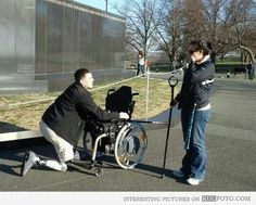 A Marine proposing on his artificial knee! A real hero!