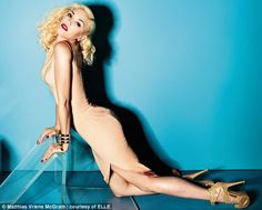 Cover girl: Gwen Stefani has revealed keeping her figure is a daily struggle and she works out five times a week in an interview in the April edition of Elle magazine