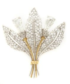 An 18 Karat Yellow and White Gold and Diamond Brooch, M. Buccellati, in a floral motif, containing two fancy step cut diamonds weighing approximately 4.12 carats total and numerous round brilliant cut diamonds weighing approximately 2.00 carats total. Stamped: 750 15 MI M Buccellati, with original box.