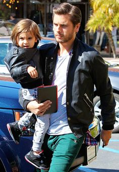 Scott Disick and son Mason match with leather jackets