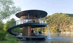Boat house located at Lake Austin- a reservoir on the Colorado River in Austin, TX. Built with Brazilian hardwood and has a waterfall, using recycled water, cascading from the 2nd. story. Would love to see the inside.