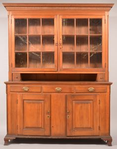 "Sold $2,200 Lancaster county, Pennsylvania Chippendale Softwood Two Part Dutch Cupboard. Cove molded and reeded cornice, two 9 pane glazed upper doors, open pie shlf with two reeded front dovetailed candle drawers. Base with three split lip molded dovetailed drawers, two raised panel lower doors, molded base with ogee bracket feet. 74-1/2""h. x 67""w. x 20-1/2""d. Condition: Good with wear and old refinish."
