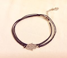 A personal favorite from my Etsy shop https://www.etsy.com/listing/187738187/hamsa-hand-ankletblack-anklet-with-hamsa