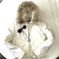 🎉Host Pick🎉Final Price Haute Ralph Lauren🎄Parka Be warm and...glamorous! Ralph Lauren Ivory silky down parka with adjustable coyote fur rimmed hood. Awesome Double Zipper so you can zip up the bottom when you sit down. Zipper pockets on exterior upper sleeves, either side of parka and in interior. 55% down + feather plume. Cinch waist on the inside gives great shape☺️ Pre-loved flawless. 🎉Fashion Favorites Host Pick🎉 Ralph Lauren Jackets & Coats