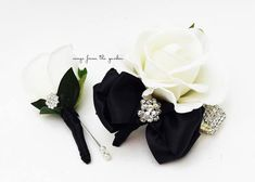 For the mother and father of the bride or groom, this Real Touch rose boutonniere and corsage set is accented with rhinestone accents with black ribbon and can be customized for your color scheme. If you need multiple boutonnieres and corsages, just contact me and I can create a custom order just for you! This real touch rose boutonniere features a white real touch rose accented with a rhinestone button. The stem is wrapped in black satin ribbon. This real touch rose boutonniere is…