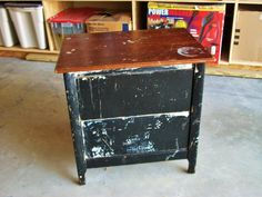 A sturdy little 2 drawer end table that looks like hell, but is in great shape.