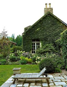 Gorgeous vine covered exterior and lush lawn