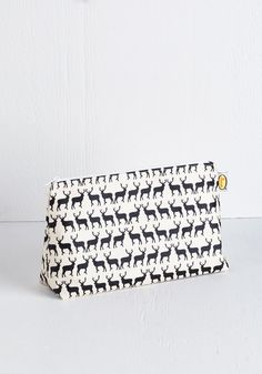 Stags to Riches Makeup Bag. Bring instant charm to your toiletry transportation with this deer-printed pouch! #multi #modcloth