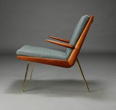 """""""Boomerang chair"""" by Peter Hvidt & Orla Mølgaard-Nielsen.Lounge chair with solid teak frame, loose cushions upholstered in bluish wool, chromed brass legs."""
