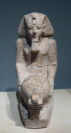 "Kneeling statue of Hatshepsut. Period: New Kingdom. Dynasty: Dynasty 18. Reign: Joint reign of Hatshepsut and Thutmose III. Date: ca. 1473–1458 B.C. Geography: Egypt, Upper Egypt; Thebes, Deir el-Bahri, ""Hatshepsut Hole"" (depression east of temple of Thutmose III). Medium: Granite, paint."