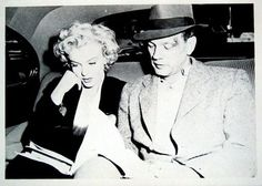 Marilyn Monroe and Joseph Cotten looking over the script together in the car.