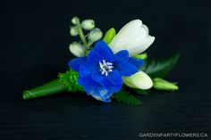 blue boutonniere by Garden Party Flowers (blue wrap for groomsmen, green for dads, and white for groom?)