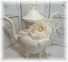 This is/was an old silver coffeepot! Beautiful!