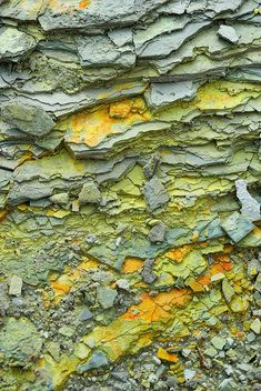 Texture at the edge of the champagne pool - Wai-o-tapu thermal wonderland, New Zealand - Blue, green, yellow, orange stone - By Jessica Rosenkrantz via Flickr
