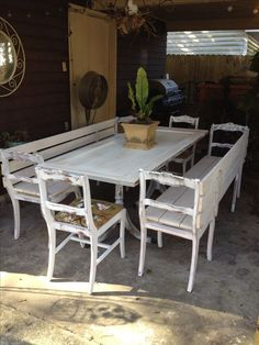 I LOVE THIS TABLE & chairs/benches‼️ Upcycle! Chairs from antique dining chairs. Bases from antique table. Old door for the table top. All painted white and shabby! Antique Dining Chairs, Outdoor Dining Chairs, Old Chairs, Patio Table, Adirondack Chairs, Dining Table, Diy Patio, Outdoor Seating, Painted Dining Chairs