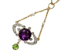 Suffragette pendant, ca 1900 - amethyst, diamond & peridot pendant of 14kt gold. Suspended from a brace of yellow gold link chain interspersed with two natural seed pearls is an elliptical (or horseshoe) form of twenty-two rose & old mine cut diamonds in silver topped 14kt yellow gold settings.