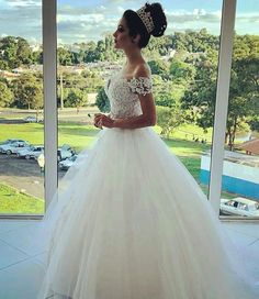 Off the shoulder #bridal #gowns like this have a Princess feel.  The traditional white ball gown look is perfect for a #Church wedding.  If you are wanting a cap or short sleeves this is an option. We make custom #weddingdresses (and replicas of couture designer dresses) for #brides all over the globe.  We at #DariusCordell can work from any of the images you have as inspiration to create your perfect dream dress.