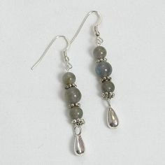 """Handmade gemstone labradorite earrings feature round, semi-precious labradorite gemstones, fishhook-style earwires, sterling silver accent beads and dangles. 2 1/2"""" in length. Add a necklace, pendant"""