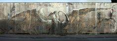 """Faith47 New Mural In Gaeta, Italy In town for the excellent Memorie Urbane Festival, the South African painter spent two days working on this stunning piece which is entitled """"Will You Stay With Me? Until The Very End"""". If you stop by Central Italy, you'll be able to find this piece at the Gaeta's cemetery."""