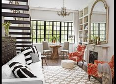 HGTV's Genevieve Gorder's New York Home. Mixed prints with neutral colors and some pops of red. love this.