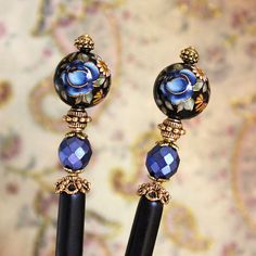 Hair sticks with pretty blue and gold accents.