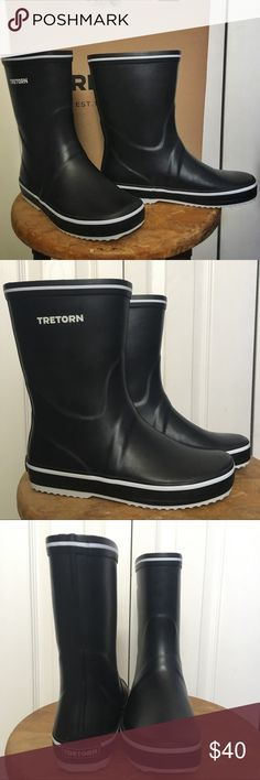 EUC Black Tretorn Storm Rubber Boots 37 Worn once!  Tretorn Storm mid-calf rain boot in black.  Euro size 37, fits like US 7.  Boots are in great shape—minor scuffing to exterior (not really noticeable), logo has worn off removable insole, white bottoms are a bit dirty (all white parts on top of boot is still bright and clean).  Comes with original box, which was damaged a bit in shipping but still structurally sound.   Purchased these to replace my yellow Tretorn Skerry boots which fit like…