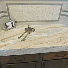 Two of our most popular countertops - Fantasy Brown Satin marble…