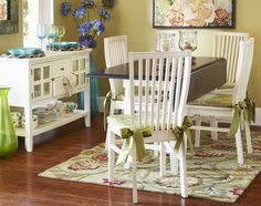 Simple white Ronan Dining Chairs serve as a good foundation for splashes of color.