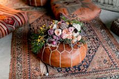 Moroccan pouf and blush-hued bouquet