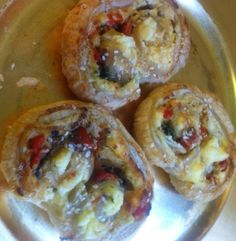 Palmier filled with red peppers, cream cheese, ham and chives.  Delicious savoury from the bakery.