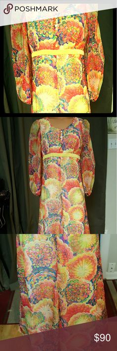 Amazing psychedelic handmade organza Maxi dress This dress is beautiful and in like new vintage condition. It has 3 yellow buttons down the front and a high empire waist yellow velvet belt. The print is stunning and looks like psychedelic flowers or fireworks exploding in yellow,pink,red,green,blue,orange,and purple colors. It has a metal zipper down the back as well. The top layer is organza and the bottom layer is satin. Measurements are Bust 36, Empire/ high waist 30, true waist…