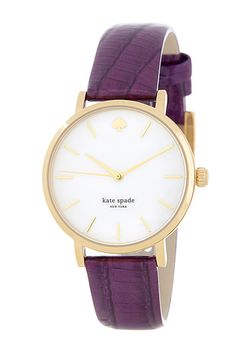Gorgeous watch with a jewel colored strap.
