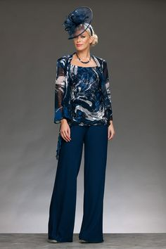 Full length chiffon trousers with an elegant wide leg. The top is embossed chiffon with a round neck and wide straps, and the jacket is matching fabric with padded shoulders and long drape hem. Wedding Trouser Suits, Mother Of The Bride Trouser Suits, Ladies Trouser Suits, Mother Of The Bride Fashion, Wedding Pantsuit, Pant Suits, Grandma Dress, Mom Dress, Plus Size Womens Clothing