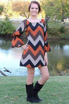 One Faith Boutique - Fall Colors Chevron Bell Sleeve Dress, $38.00 (http://www.onefaithboutique.com/new-arrivals/fall-colors-chevron-bell-sleeve-dress/)