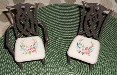 So, this is some Gloria Furniture dining room table and chairs that I ordered on Ebay.  It came pink.  I painted it brown and designed a pattern to cross stitch so it would look like tapestry seats.  It is Barbie or playscale size sitting on a placemat that looks like a rug.  Do you like?