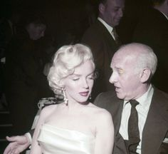 Marilyn at Ciro's for Walter Winchell's birthday party, May 1953.